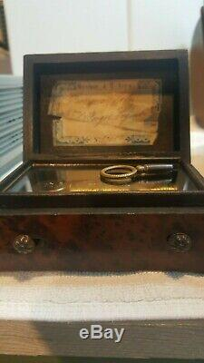Rare antique Reuge music box with key