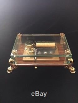 Reuge Dauphin Music Box 3/36 Movement Crystal Box on Wood Base with Gilt Feet