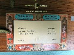 Swiss music box (bought in Switzerland and hand-carried to USA in 1970)