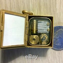 Vintage Reuge Swiss Music Box Pendant Silver 800 working book photo locket