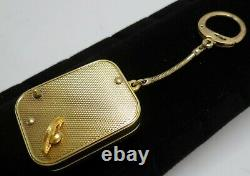 Vintage Swiss Made Reuge Ste Croix Gold-tone Music Box Keychain